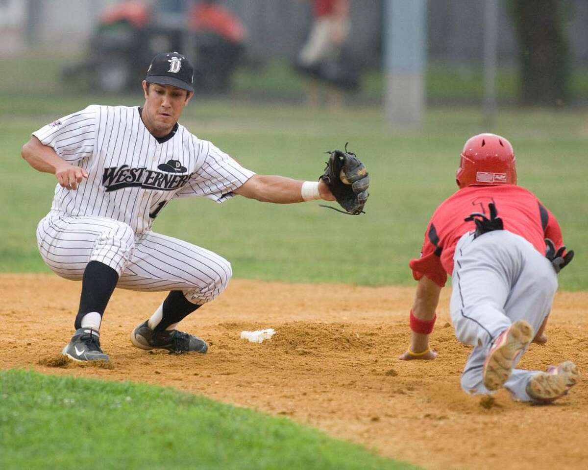 Westerners' shortstop Alfredo Rodriguez has the ball in plenty of time to catch Jimmy Ralph of the Canadian Junior National team stealing. Catcher Thor Meeks made the strong throw Monday night at Rogers Park.