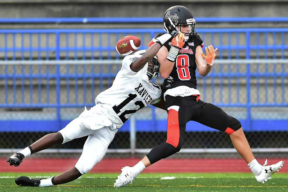 Xavier's Osiah Wiggins, left, breaks up a pass intended for Shelton's David Yakowicz on Thursday in West Haven. Photo: Catherine Avalone / Hearst Connecticut Media / New Haven Register
