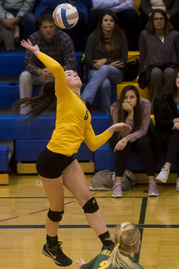 Dow High's Isabel Velasquez goes up for a spike in a match against Midland High in October 2017. Photo: Daily News File Photo