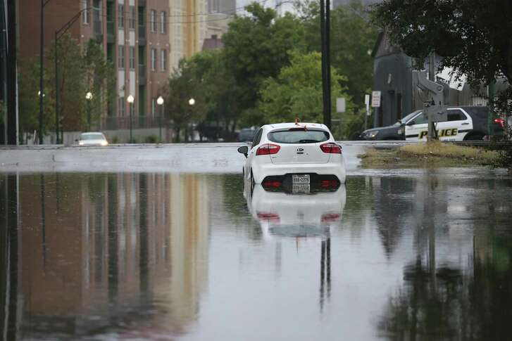 A car stalled in high water at the 600 block of East Crockett on Sept. 4, 2018. San Antonio is close to breaking the 1946 record of 15.78 inches of rain for the wettest September.