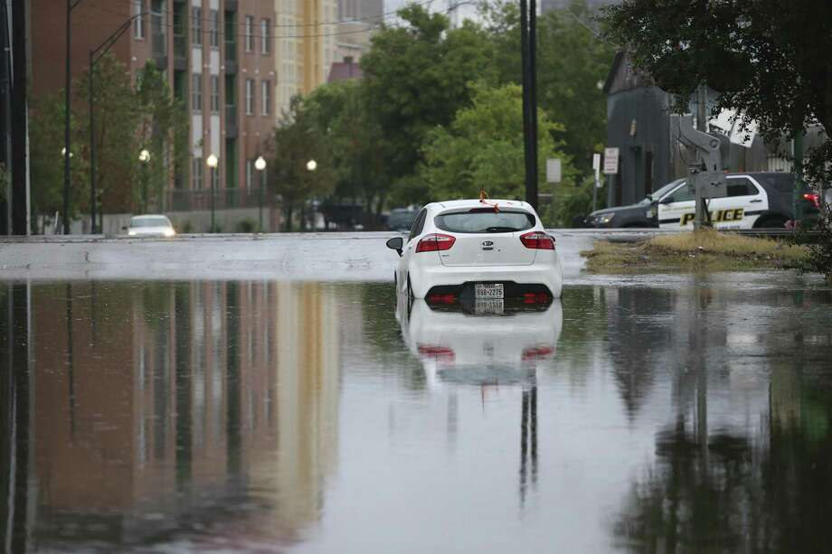 A car stalled in high water at the 600 block of East Crockett on Sept. 4, 2018. San Antonio is close to breaking the 1946 record of 15.78 inches of rain for the wettest September. Photo: Jerry Lara /Staff Photographer / © 2018 San Antonio Express-News