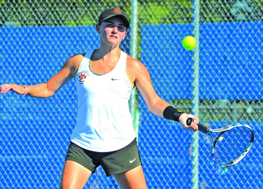 Edwardsville senior Abby Cimarolli makes a forehand return during her No. 3 singles match against Belleville East's Abigail McIsaac Thursday at Belleville East. Photo: Scott Marion