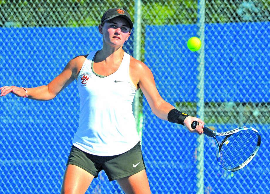 Edwardsville senior Abby Cimarolli makes a forehand return during her No. 3 singles match against Belleville East's Abigail McIsaac Thursday at Belleville East. Photo: Scott Marion