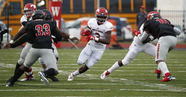 North Shore running back Zachary Evans (3) runs the ball during the first half of a high school football game at Geroge Stadium,  Thursday,  September 13, 2018, in Spring.