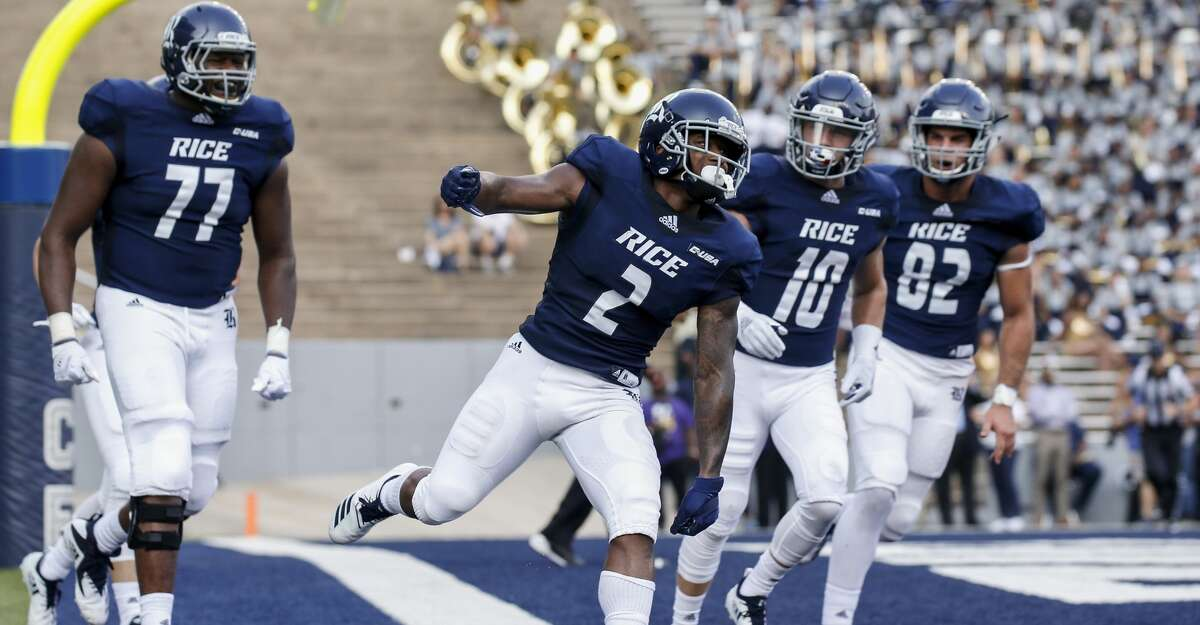 HOUSTON, TX - AUGUST 25: Austin Walter #2 of the Rice Owls celebrates after rushing for a touchdown against the Prairie View A&M Panthers in the first quarter at Rice Stadium on August 25, 2018 in Houston, Texas. (Photo by Tim Warner/Getty Images)