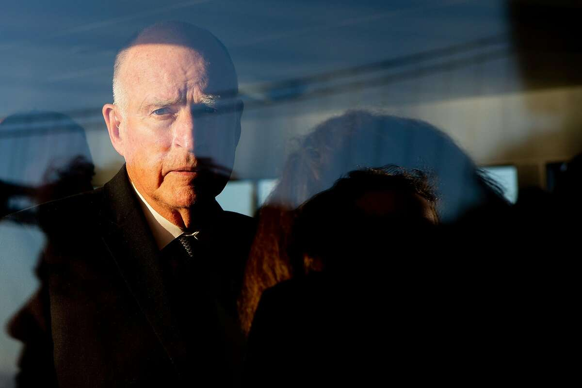 Gov. Jerry Brown looks out the window while aboard the maiden voyage of a clean-energy ferry.