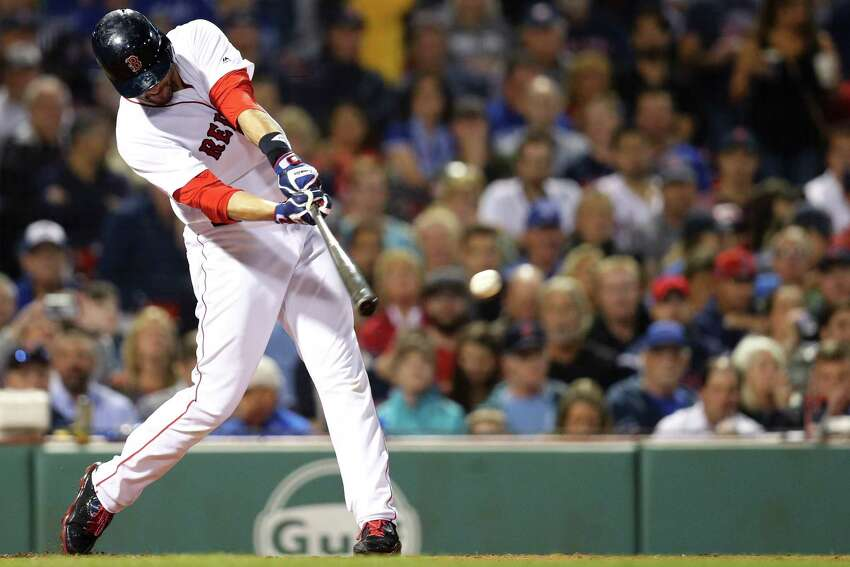 BOSTON, MA - SEPTEMBER 13: J.D. Martinez #28 of the Boston Red Sox hits a single during the third inning at Fenway Park on September 13, 2018 in Boston, Massachusetts.(Photo by Maddie Meyer/Getty Images)