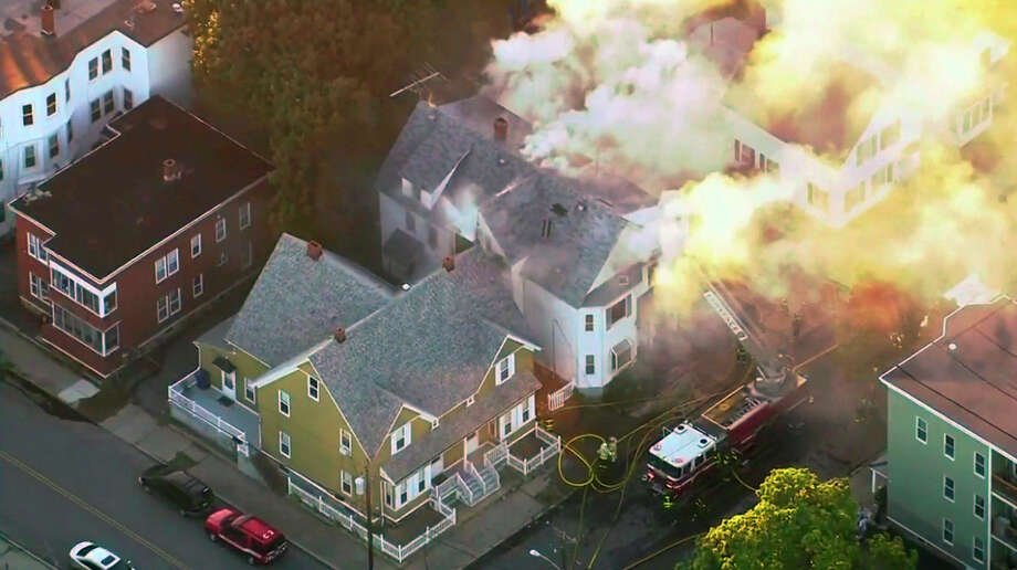 In this image take from video provided by WCVB in Boston, firefighters battle a large structure fire in Lawrence, Mass, a suburb of Boston, Thursday, Sept. 13, 2018. Emergency crews are responding to what they believe is a series of gas explosions that have damaged homes across three communities north of Boston. (WCVB via AP) / WCVB