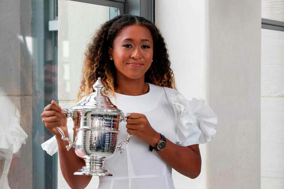 Naomi Osaka of Japan poses with her championship trophy at the Rock Observation Deck at Rockefeller Center in New York on September 09, 2018, the morning after defeating Serena Williams of the United States, winning the 2018 US Open Women's Singles Finals. (Photo by EDUARDO MUNOZ ALVAREZ / AFP)EDUARDO MUNOZ ALVAREZ/AFP/Getty Images Photo: EDUARDO MUNOZ ALVAREZ / AFP or licensors