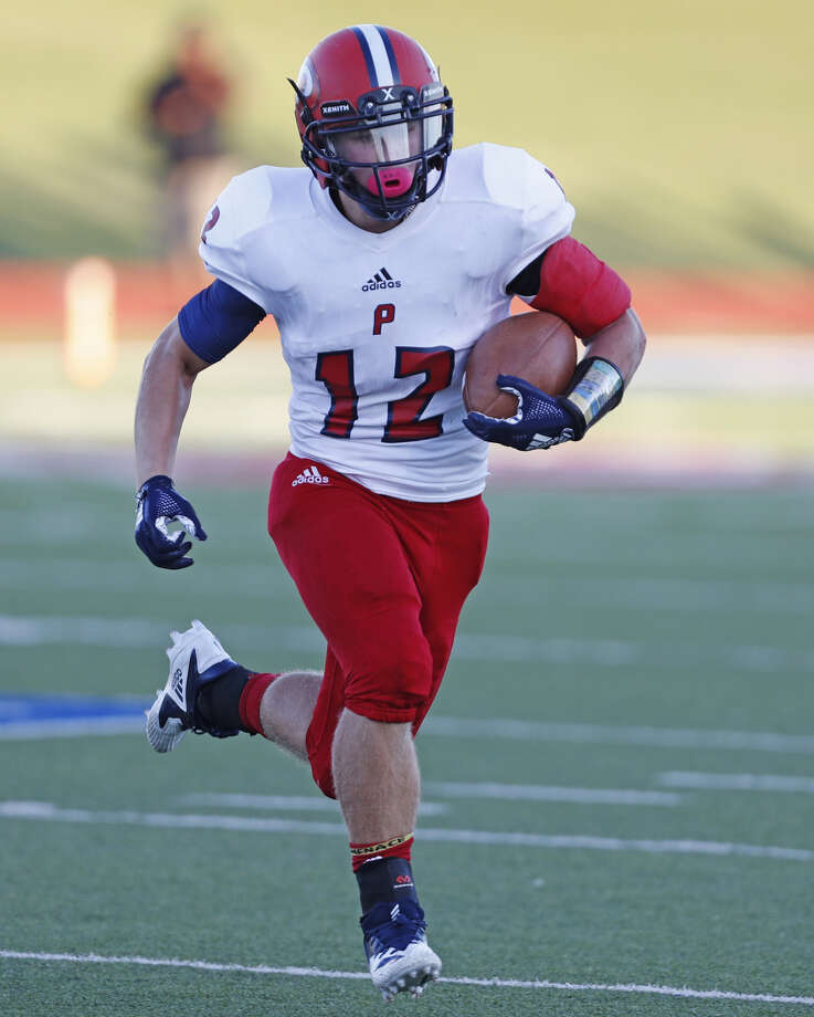 Plainview junior tailback Peyton McNutt picks up a first down against Lubbock High during the Week Three contest on Thursday night at Lowery Field in Lubbock. The Bulldogs beat the Westerners, 21-14, for their first win of the season. Photo: Brad Tollefson/Lubbock Avalanche-Journal