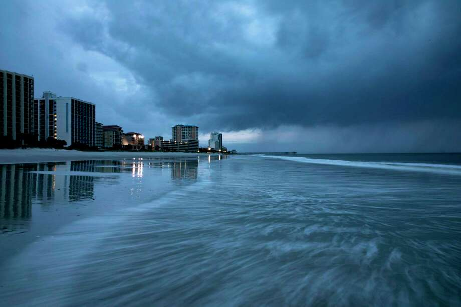 Rain begins to fall as the outer bands of Hurricane Florence make landfall in Myrtle Beach, South Carolina on September 13, 2018. - Hurricane Florence edged closer to the east coast of the Hurricane Florence edged closer to the east coast of the US Thursday, with tropical-force winds and rain already lashing barrier islands just off the North Carolina mainland. The huge storm weakened to a Category 2 hurricane overnight, but forecasters warned that it still packed a dangerous punch, 110 mile-an-hour (175 kph) winds and torrential rains. (Photo by Alex Edelman / AFP)ALEX EDELMAN/AFP/Getty Images Photo: ALEX EDELMAN / AFP or licensors