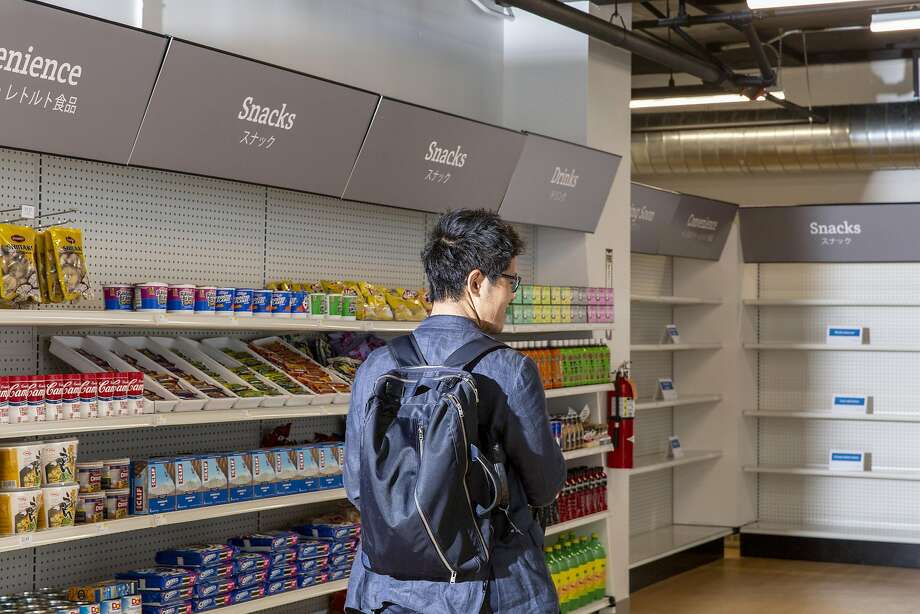 Yoshimasa Takahashi visits Standard Market, San Francisco's first cashierless and checkoutless grocery store, Sept. 7, 2018. Shoppers who have downloaded the store's app can grab items and simply leave.; cameras identify the shopper and the items, and determine when said items leave with said shopper. At least, that's the idea.  Photo: CAYCE CLIFFORD, NYT