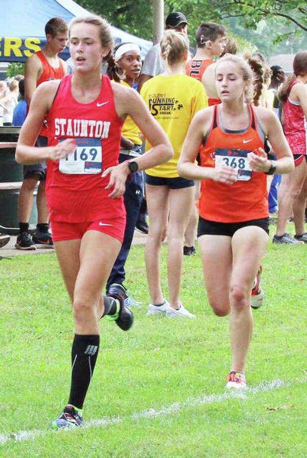 Staunton sophomore Lydia Roller (left) and Edwardsville senior Hannah Stuart run third and fourth midway through the Granite City Invite on Sept. 1. Photo: Greg Shashack / The Telegraph