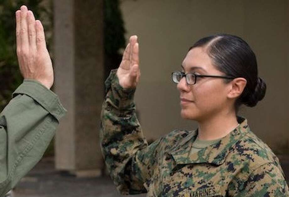 Cpl. Remedios Cruz, who was reduced in rank from sergeant, is facing discharge after pleading guilty to fraternization as part of a deal to avoid going to trial. According to the New York Times, in the Article 32 hearing —the military's version of a grand jury proceeding — the presiding official advised against a full-blown court-martial. Photo: Lance Cpl. Richard Currier/US Marine Corps