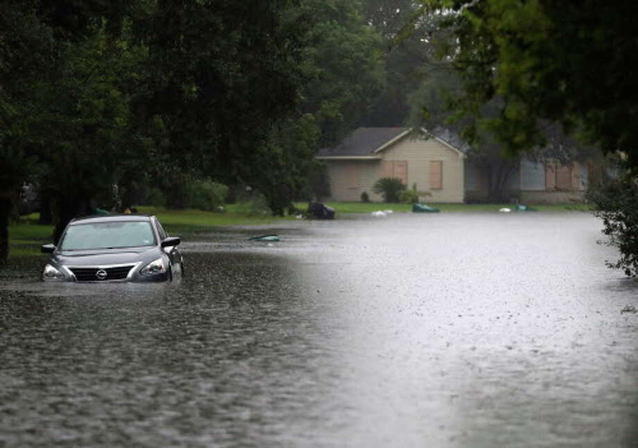 A car is submerged in floodwater Tuesday, Sept. 11, 2018, in La Marque, Texas.  Photo: Kelsey Walling, Associated Press / © 2018 Kelsey Walling/The Galveston County Daily News