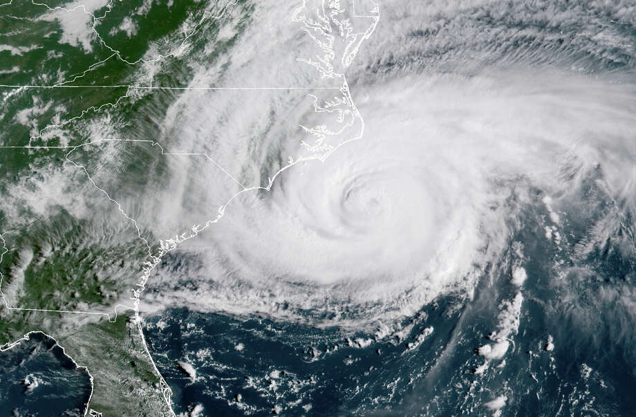 This satellite image provided by NOAA shows Hurricane Florence on the eastern coast of the United States on Friday, Sept. 14, 2018. (NOAA via AP) Photo: AP / NOAA