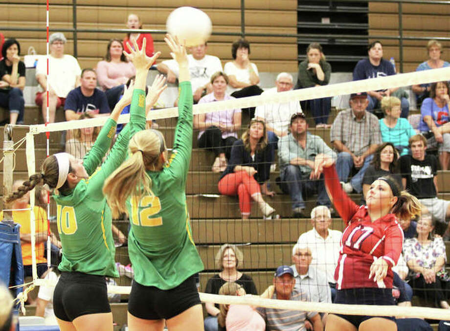 Carlinville's Kelsey McKee (right) hits over the block of Southwestern's Lexy Hall (12) and Karlee Paslay during a nonconference match Aug. 30 in Carlinville. Both the Cavaliers and the Piasa Birds were in South Central Conference action Thursday, with the Cavs winning in Vandalia and the Birds losing in Greenville. Photo: Greg Shashack / The Telegraph