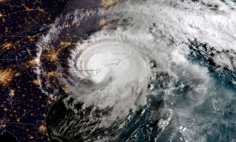 In this NOAA satellite handout image captured at 7:45 a.m. ET, shows Hurricane Florence as it made landfall near Wrightsville Beach, North Carolina on September 14, 2018. The National Hurricane Center reported Florence had sustained winds of 90 mph at landfall and was moving slowly westward at 6 mph. Photo: Handout, Getty Images