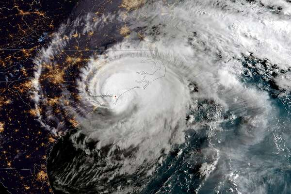 IN SPACE - SEPTEMBER 14: In this NOAA satellite handout image captured at 7:45 a.m. ET, shows Hurricane Florence as it made landfall near Wrightsville Beach, North Carolina on September 14, 2018. The National Hurricane Center reported Florence had sustained winds of 90 mph at landfall and was moving slowly westward at 6 mph. (Photo by NOAA via Getty Images)