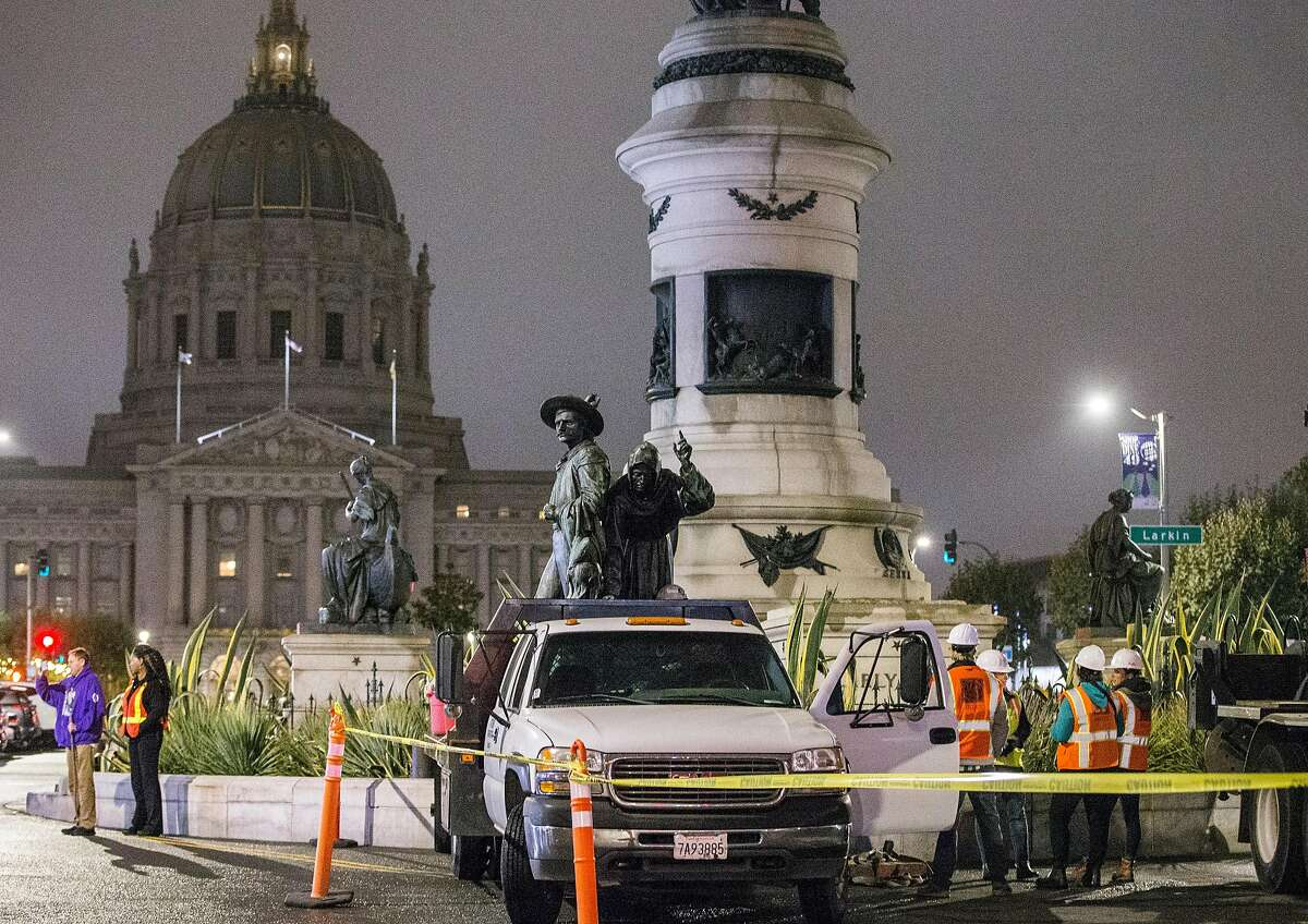 Workers place the controversial 'Early Days' statue, one of five statues that make up the Pioneer Monument, on a truck after being removed from Civic Center Plaza in San Francisco Calif. Friday, Sept. 14, 2018.