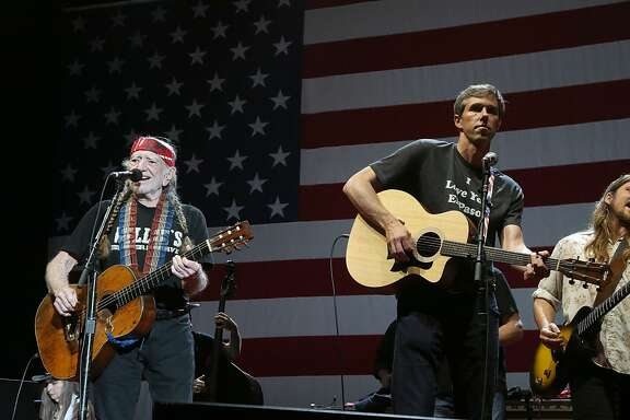 AUSTIN, TX - JULY 04: Willie Nelson (L) and Beto O'Rourke perform in concert at Willie Nelson's 45th 4th Of July Picnic at the Austin360 Amphitheater on July 4, 2018 in Austin, Texas. (Photo by Gary Miller/Getty Images for ABA)