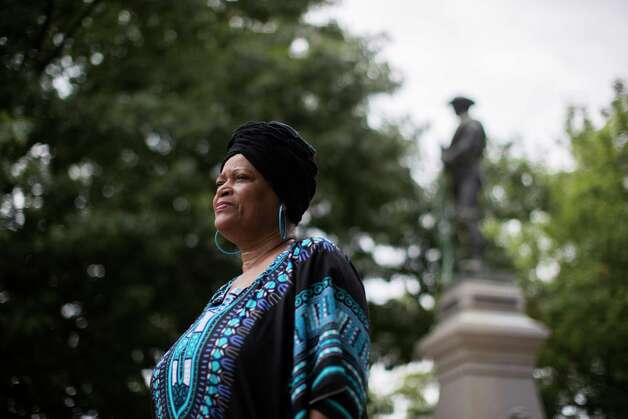 Brenda Cherry, an activist from Paris, Texas, stands by a confederate statue located by the courthouse, Friday, Sept. 7, 2018. Photo: Marie D. De Jesús, Staff Photographer / © 2018 Houston Chronicle