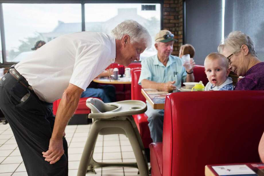 Brent McKee, owner of McKee's 24 Hour Family Restaurant, greets a baby during breakfast, Friday, Sept. 7, 2018, in Paris. Photo: Marie D. De Jesús, Staff Photographer / © 2018 Houston Chronicle