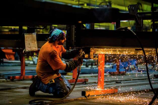 A Load Trail welder works on the frame of a trailer at the manufacturing plant, Thursday, Sept. 6, 2018, in Sumner.  Photo: Marie D. De Jesús, Staff Photographer / © 2018 Houston Chronicle