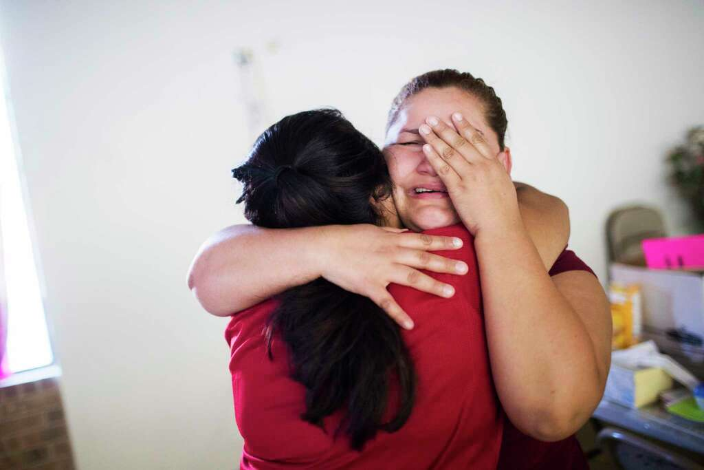 Nora Lopez, 25, becomes emotional as Dalila Reynoso embraces her, Wednesday, Sept. 5, 2018, in Paris, after being informed that her partner will be released on bond the following day. Lopez's partner was one of the workers detained during the Load Trail raid. Photo: Marie D. De Jesús, Staff Photographer / © 2018 Houston Chronicle