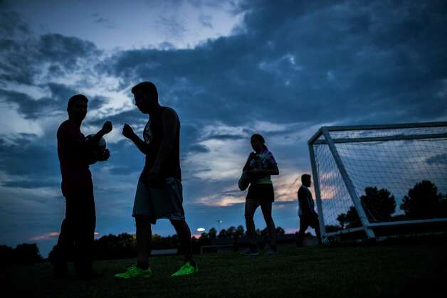 Members of the Iglesia Fuente De Agua Viva in Paris, Texas fist bump after playing a soccer match, Thursday, Sept. 6, 2018, in Paris. Some of the members of the church knew several individuals who were detained by the U.S. Immigration and Customs Enforcement on Tuesday, August, 28, 2018 in Sumner during the immigration raid at Load Trail. Photo: Marie D. De Jesús, Staff Photographer / © 2018 Houston Chronicle