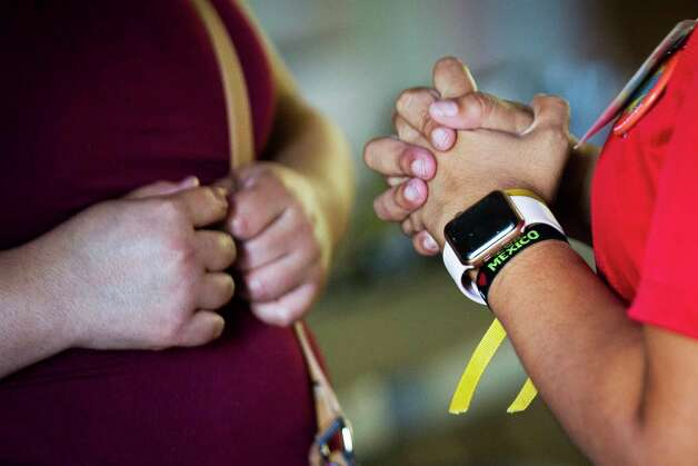 "Dalila Reynoso, who has led the volunteer effort in Paris, keeps an ""I love Mexico"" bracelet on her wrist.  Photo: Marie D. De Jesús, Staff Photographer / © 2018 Houston Chronicle"