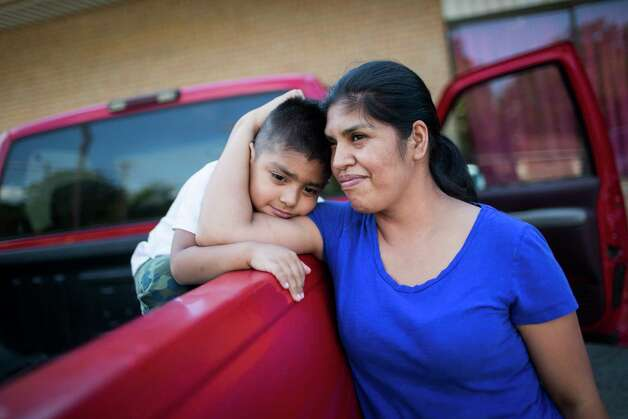 Maria del Carmen Castrejon, 37, shares a moment with her son Misael Arenas, 4, after picking up groceries at the Iglesia Evangelica Filadelfia in Paris, Wednesday, Sept. 5, 2018. Castrejon was one of the 159 workers detained during an immigration raid Tuesday, Aug. 28, 2018 near Paris, Texas.  Photo: Marie D. De Jesús, Staff Photographer / © 2018 Houston Chronicle