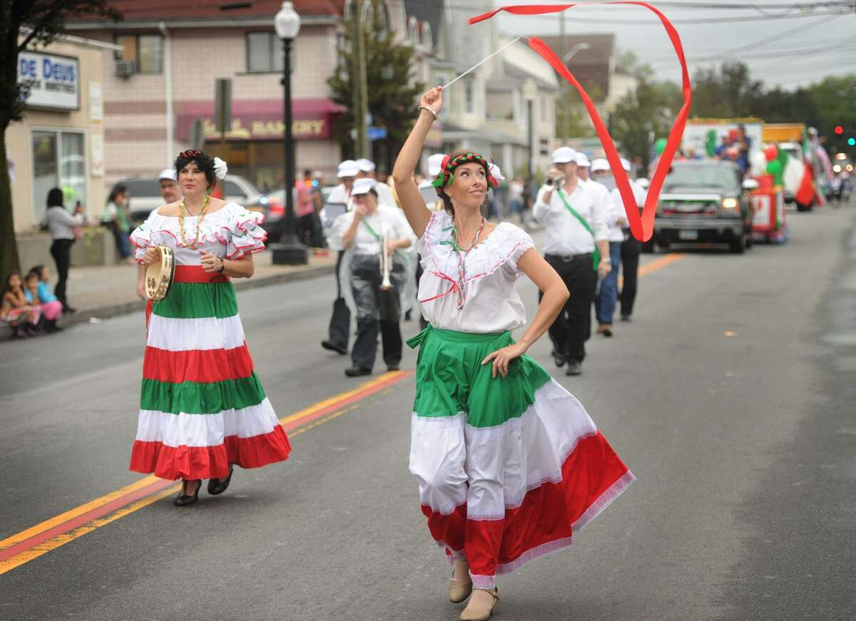 Stacey Ziegler, fellow dancers, and a brass band playing Italian music, march with B.A.C.I.O, the Bridgeport Area Cultural Italian Organization, in the 2017 Columbus Unity Parade in Bridgeport. Unable to resolve a dispute with Mayor Joe Ganim's administration over police overtime costs, the parade committee Thursday night voted to move the event to neighboring Shelton, ending a 109 year tradition in the city.