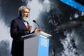 Actor Harrison Ford addresses a crowd at the Global Climate Action Summit in San Francisco on Sept. 13, 2018.