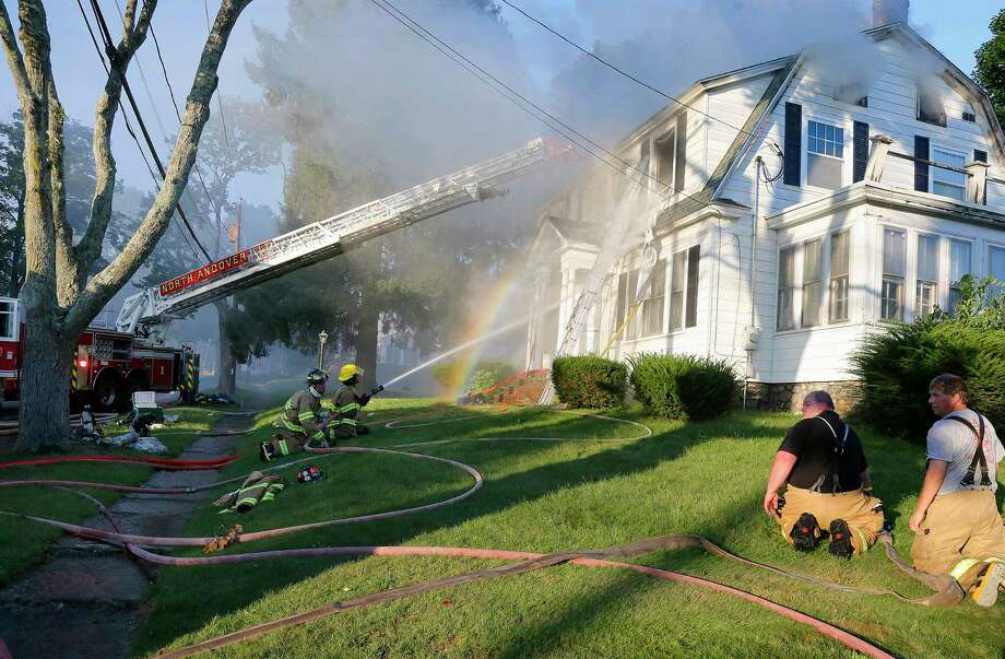 Firefighters battle a house fire, Thursday, Sept. 13, 2018, on Herrick Road in North Andover, Mass., one of multiple emergency crews responding to a series of gas explosions and fires triggered by a problem with a gas line that feeds homes in several communities north of Boston. (AP Photo/Mary Schwalm) Photo: Mary Schwalm, Associated Press / Copyright 2018 The Associated Press. All rights reserved