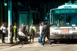 """A Muni bus displays a message """"Please Call Police 911"""" as an altercation temporarily halts Fillmore St. service on Thursday, Sept. 13, 2018, in San Francisco"""