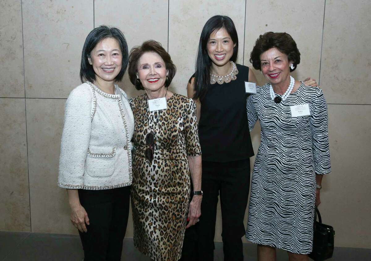 Anne Chao, from left, Cyvia Wolff, Carolyn Sabat and Kathy Goossen pose for a photograph at the Women in Culinary Arts Luncheon at Asia Society Texas Center on Thursday, Sept. 13, 2018, in Houston.