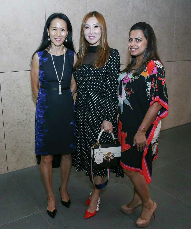 Y. Ping Sun, from left, Mandy Kao and Ruchi Mukherjee pose for a photograph at the Women in Culinary Arts Luncheon at Asia Society Texas Center on Thursday, Sept. 13, 2018, in Houston.