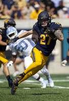 California's Ashtyn Davis (27) runs back a kickoff against North Carolina during the second half of an NCAA college football game, Saturday, Sept. 1, 2018, in Berkeley, Calif. California won 24-17. (AP Photo/D. Ross Cameron)