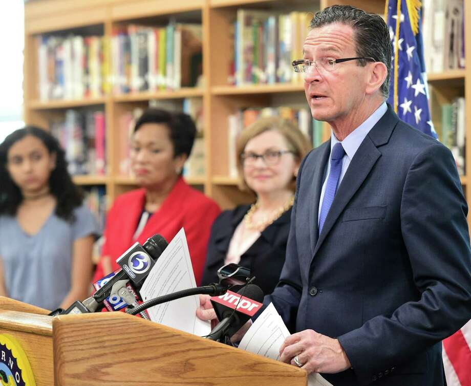 (Peter Hvizdak - New Haven Register) Governor Dannel P. Malloy and State Department of Education Commissioner Dianna R. Wentzell announced during a press conference at Hillhouse High School Monday morning, April 1, 2017 that graduation rates in the state reached an all-time high during the 2016 school year. Photo: ©2017 Peter Hvizdak / ©2017 Peter Hvizdak