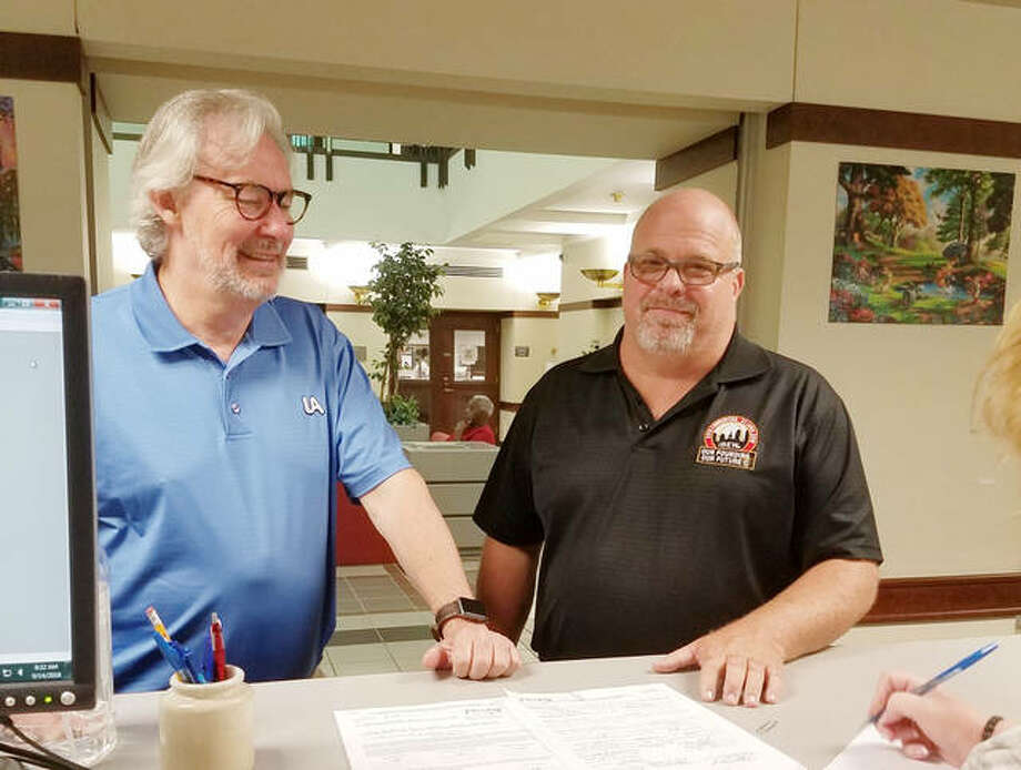Madison County Democratic Party Chairman Mark Von Nida, left, with Chris Hankins as he filed his paperwork Friday morning at Madison County Clerk's Office. Photo: For The Telegraph