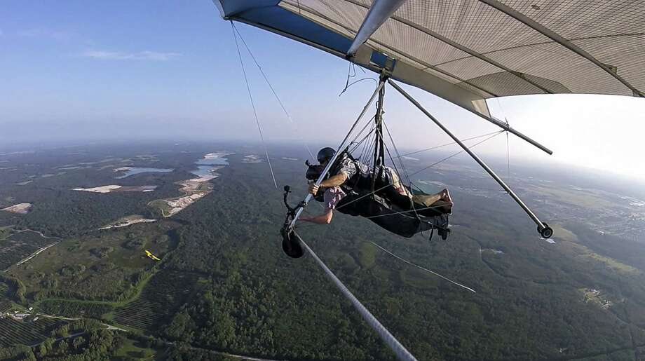 As seen from a mounted GoPro, Central Florida Explorer Patrick Connolly hang glides with Wallaby Ranch owner and instructor Malcolm Jones at Wallaby Ranch in Davenport on Aug. 23, 2018. (Wallaby Ranch) Photo: Wallaby Ranch / Orlando Sentinel