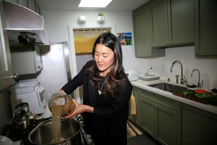 "Kristin Eriko Posner makes Tsukune ""Matzah Ball"" soup in her kitchen on Wednesday, August 22,  2018 in San Francisco, Calif."