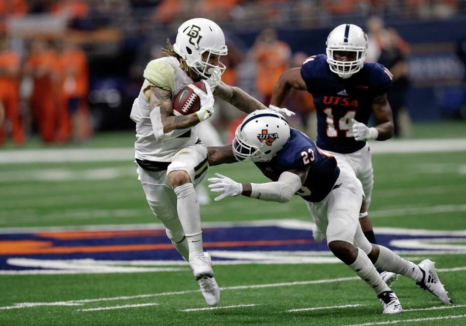UTSA wide receiver Jalen Hurd (5) tries to avoid a hit by UTSA safety Darryl Godfrey (23) following a catch during the second half of an NCAA college football game, Saturday, Sept. 8, 2018, in San Antonio. (AP Photo/Eric Gay) Photo: Eric Gay, Associated Press / Copyright 2018 The Associated Press. All rights reserved.