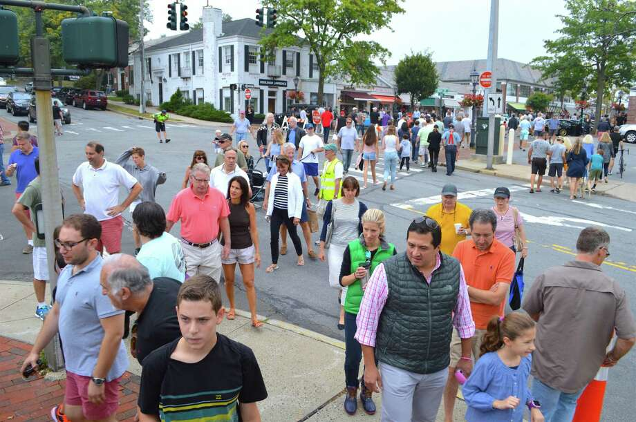 Downtown was swarming with people for the Caffeine & Carburetors auto show, in 2017. Photo: Jarret Liotta / For Hearst Connecticut Media / New Canaan News Freelance
