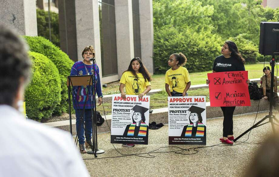 "Professor Angela Valenzuela of Department of Educational Leadership and Policy speaks to protesters as Karen Acua, 13, and Modesta Bocanegra, 13, both seventh-graders at KIPP Camino Academy, and their Mexican-American studies teacher Lucero Saldaa hold signs as they join a June protest and rally before the Texas State Board of Education meeting on what to teach in a newly approved name of ""ethnic studies course."" Photo: Thao Nguyen, For San Antonio Express-News / Thao Nguyen"