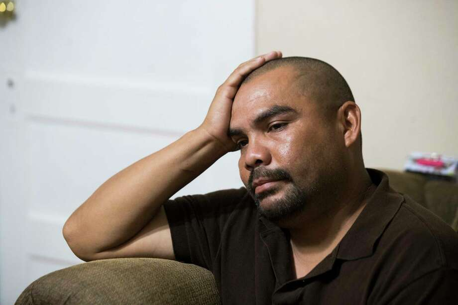 Juan Esquivel, 39, becomes emotional at his home in Honey Grove, Wednesday, Sept. 5, 2018. Esquivel is one of the 159 workers who were detained during the ICE raid at Load Trail, Tuesday, August, 28, 2018 in Sumner. Photo: Marie D. De Jesús, Staff Photographer / © 2018 Houston Chronicle