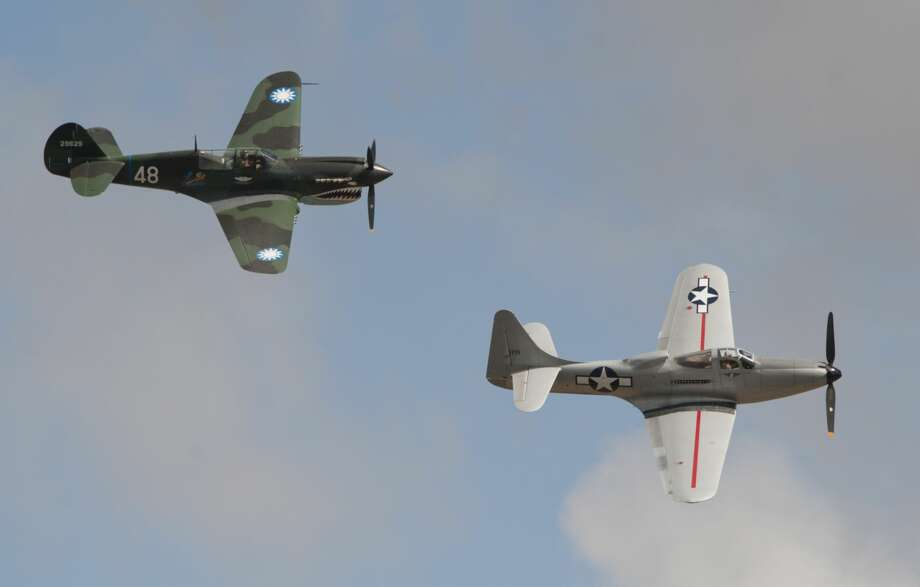 A P-40 Warhawk and a P-63 King Cobra fly in formation 09/14/18 during the Special Air Show for Special People presentation of the High Sky Wing Commenorative Air Force Airsho 2018. Tim Fischer/Reporter-Telegram Photo: Tim Fischer/Midland Reporter-Telegram