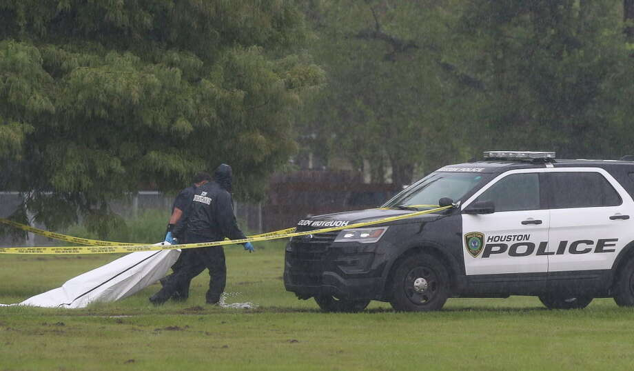 HPD authorities taking a male's body away after investigating the scene at Beverly Hills Park on Friday, Sept. 14, 2018, in Houston. The deceased was about 25 years old Hispanic with  many tattoos. The deceased was shot multiple times at torso and head. Photo: Yi-Chin Lee, Staff Photographer / © 2018 Houston Chronicle