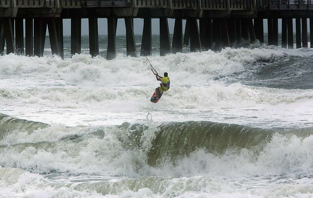 Kite Boarder Dimitri Maramenides heads out next to Jennette's Pier in Nags Head, N.C., as Hurricane Florence makes landfall further south on Friday, Sept, 14, 2018.